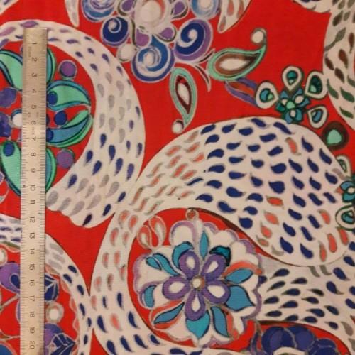 Tissu jersey fluide motif coloré sur rouge (par 10cm)